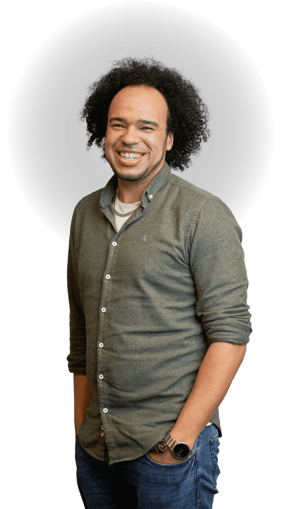 Standing portrait of Kyle Welsby smiling with iconic curly hair